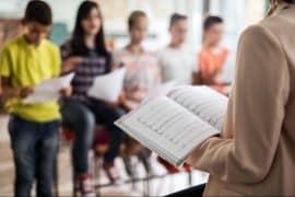 Singing teacher with children
